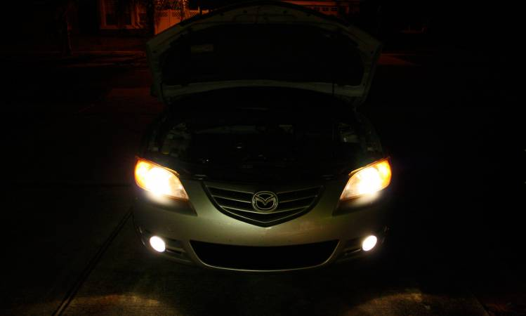 mazda3 with new headlight bulbs_normal replace the headlight bulb on a mazda 3  at crackthecode.co